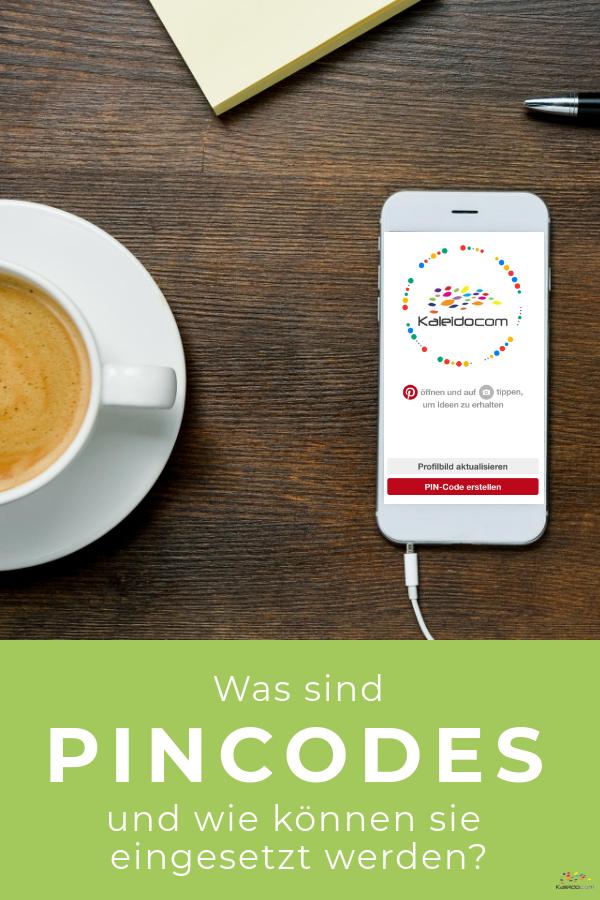 Handy mit Pincode und Kaffeetasse am Tisch